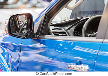 rearview mirror on the motor vehicle, note shallow depth of...