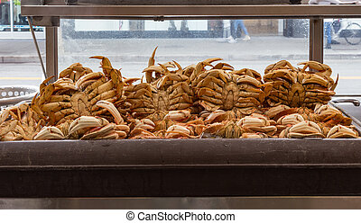 Cooked crabs in a refrigerator at a crab shack in San...