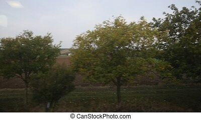 View from a train window - autumn meadow in Europe, wide...