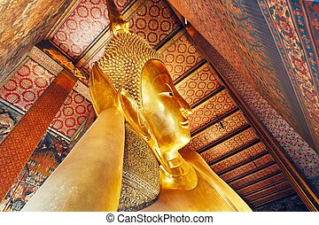Golden statue of the Reclining Buddha in Wat Pho (Pho...