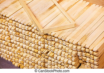 wooden moldings for frames for honeycombs, note shallow...