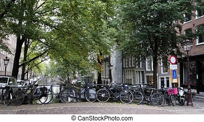 Amsterdam street with bicycles on canal, Autumn,...