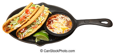 Chalupa and Pinto Beans on Cast Iron Skillet Over White