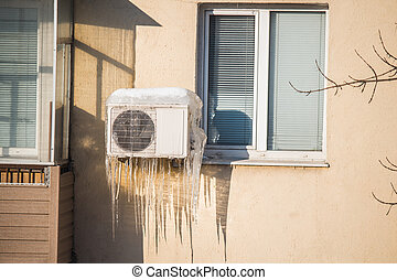Frozen air conditioner icicles - Large icicles hanging from...