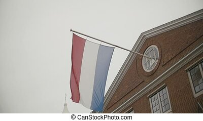 Flag of Netherlands flying on building in Amsterdam,...