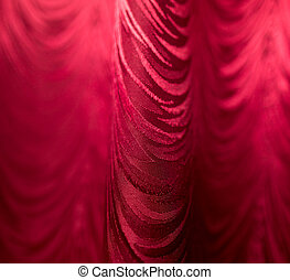 Red fabric curtain as a backdrop.