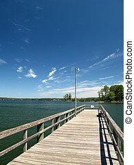 Fishing Dock - A fishing pier at a lake on a clear day