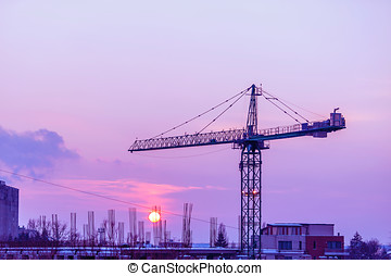 Industrialized area at the sunset with a crane. Industrial...