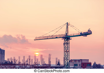 Vibrant sunset in an area of the city with a crane