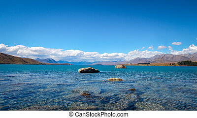 Panoramic landscape view of Lake Tekapo and mountains, New...