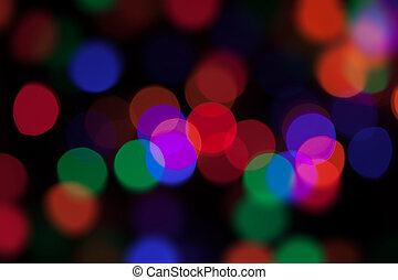 Large coloured party lights at night