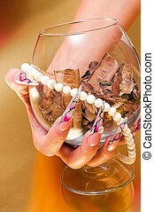 Beautiful long nails - Hand with artificial nails holding...