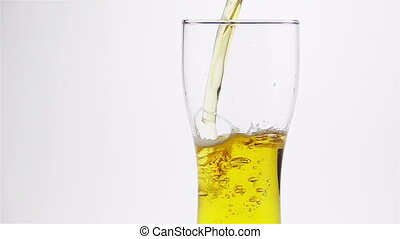 Light Beer is Poured into the Glass on a Light Background....