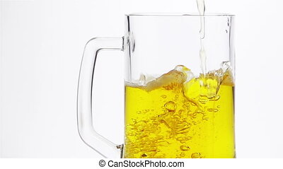 Light Beer is Poured into a Beer Mug on a Light Background....