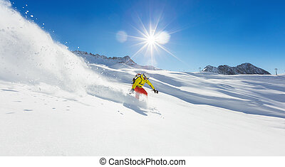 Freerider snowboarder running downhill in beautiful Alpine...