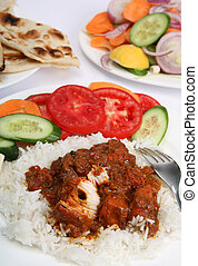 Chicken tikka masala meal vertical - A meal of chicken tikka...