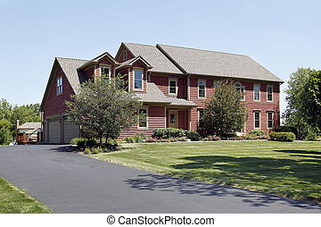 Home with red siding - Large home in suburbs with red siding
