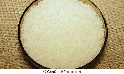 Portion of rice in a bowl, close-up, with rotation