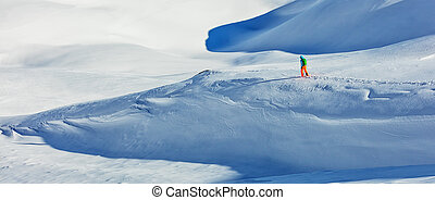 Freerider alpine skier walking in fresh snow - Freerider...