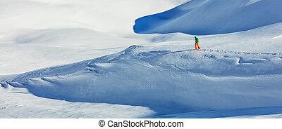 Freerider alpine skier walking in fresh snow - Freerider...