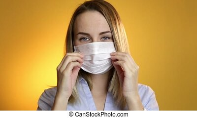 Close up of a female surgeon's face wearing surgical mask.