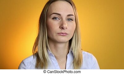 pensive woman gets an idea on yellow background.
