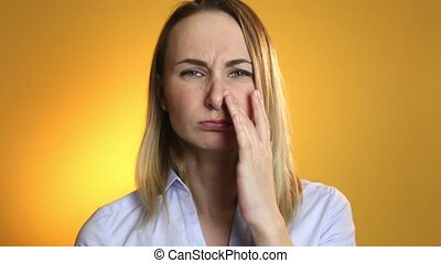 Woman applies nasal spray isolated. - Woman applies nasal...