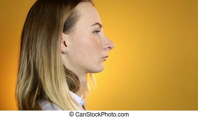 Girl with quinsy taking medicine on yellow background