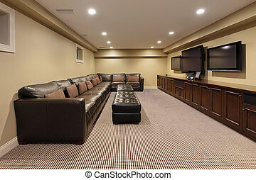 Basement of luxury home with wall of cabinetry
