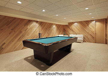 Pool table in basement - Pool table in suburban home with...