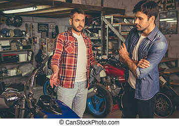 Guys at the motorbike repair shop - Handsome guys are...