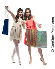 shopping women - Two attractive girls with shopping bags...