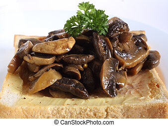 Mushrooms on toast - Sauteed mushrooms, topped with a sprig...