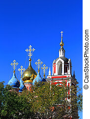 Orthodox temple behind trees - Domes of the Orthodox church...