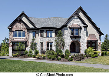 Luxury stone and brick home with arched entry