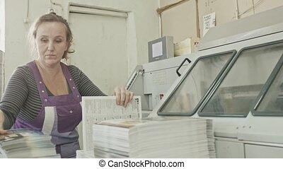 Polygraph printing process - a woman's manual labor - making...