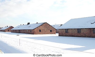 Auschwitz Birkenau barracks in winter. German Nazi concentration and extermination camp