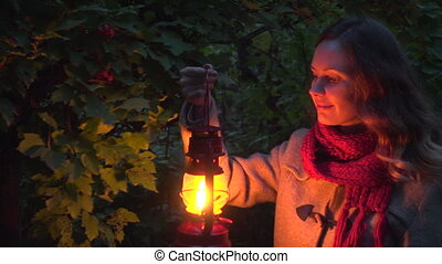 Girl hang with lantern in dark autumn forest - Adorable girl...