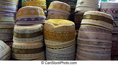 Muslim caps on sale in Doha - Piles of muslim traditional...