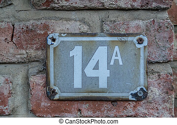 sign for house number 14A
