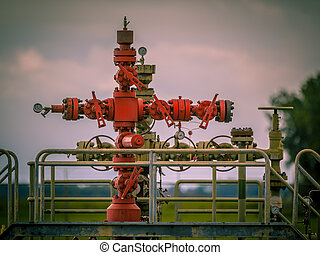 Gas field well head vintage - Vintage style Well head of a...