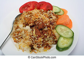 Mutton biriyani curry, with rice and salad