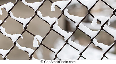 Snow on fence in winter