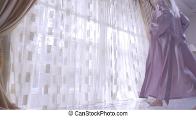 Woman Opening Curtains - Young Woman In Panties Opening...