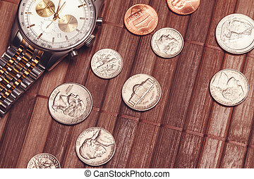 Luxury but not new watch with coins. Cost-is-no-object, time...