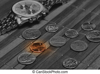 Poor income concept - Watch with coins. Cost-is-no-object,...