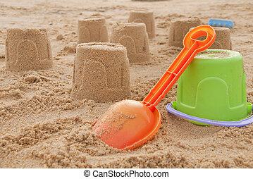 shovel and pail - shovel in the sand on the beach