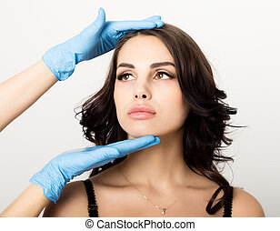 Closeup of Beautiful young woman gets injection in eye and...