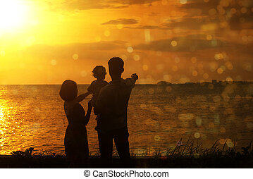 Silhouette of family in outdoor sunset