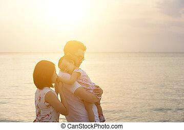 Family enjoying summer holiday at beach